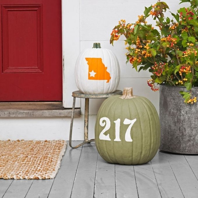 address stencilled on pumpkins front porch