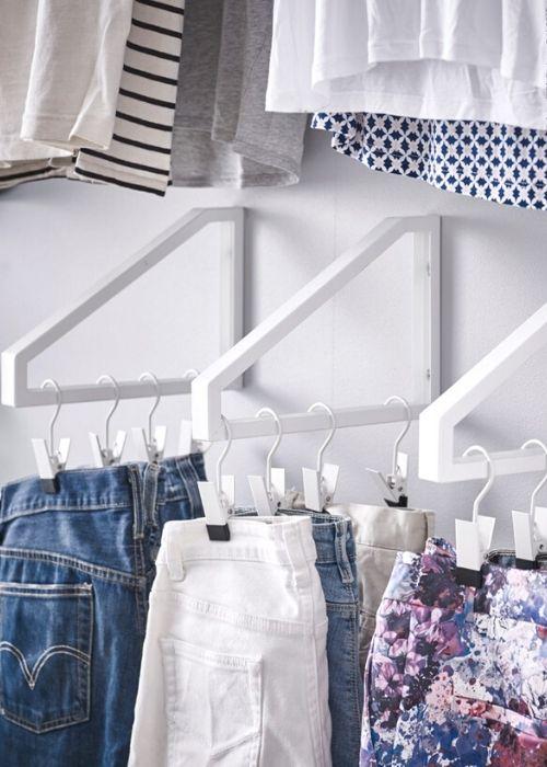 clothes hanging on shelf bracket IKEA storage idea