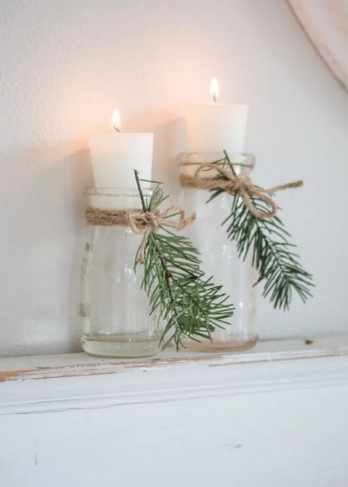 recycled christmas candle jars with evergreen sprigs