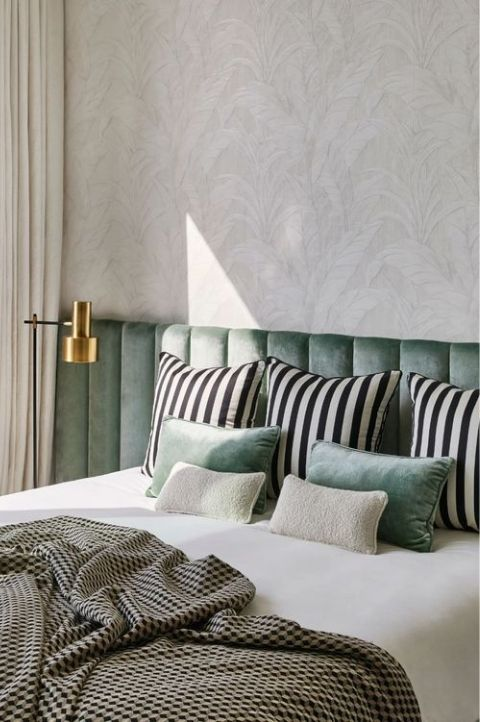 simple art deco bedroom with green and black patterns