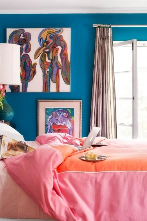 bold and bright maximalist bedroom with heavy feminine style, pink and blue interior decor