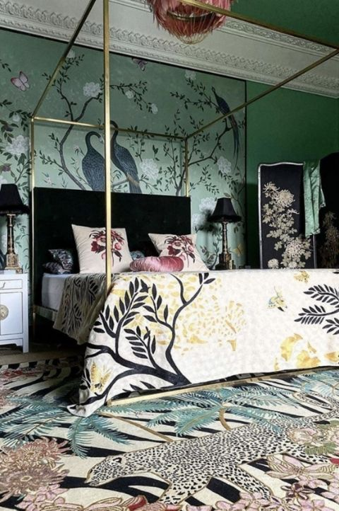 chinese styled maximalist bedroom with animal prints, green walls and jade rugs