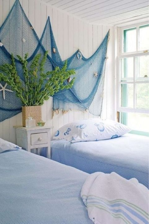 coastal themed twin room with seashore netting