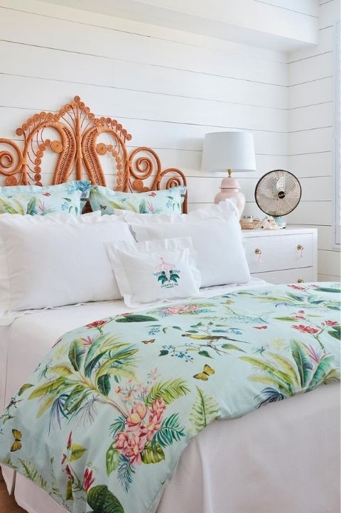 tropical princess style coastal bedroom with woven headboard