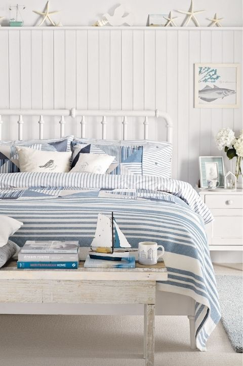 coastal bedroom with nautical vibes and accessories