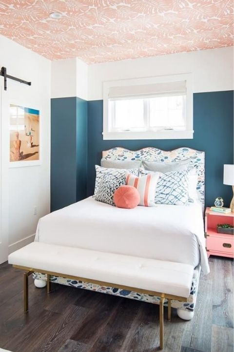 retro coastal bedroom with vintage artwork