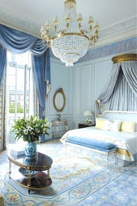 classic, regal Parisian bedroom with plush blue and gold accessories