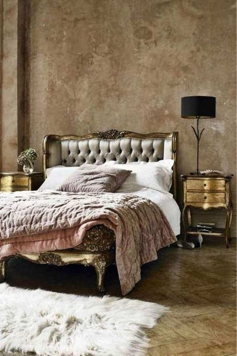 lush, chic bedroom with golden bed frame