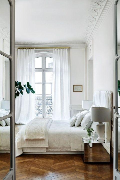 minimalist Parisian bedroom with natural light