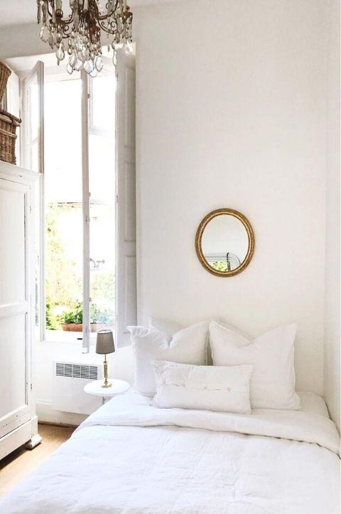 small Parisian bedroom idea, natural light, bright, small mirror