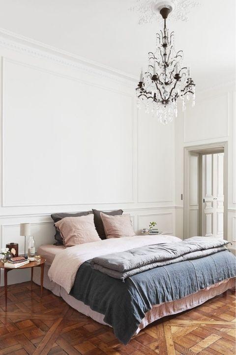 dark panelled wood floors in Parisian bedroom apartment