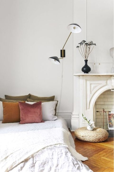 Parisian bedroom with bed on floor and vintage accessories