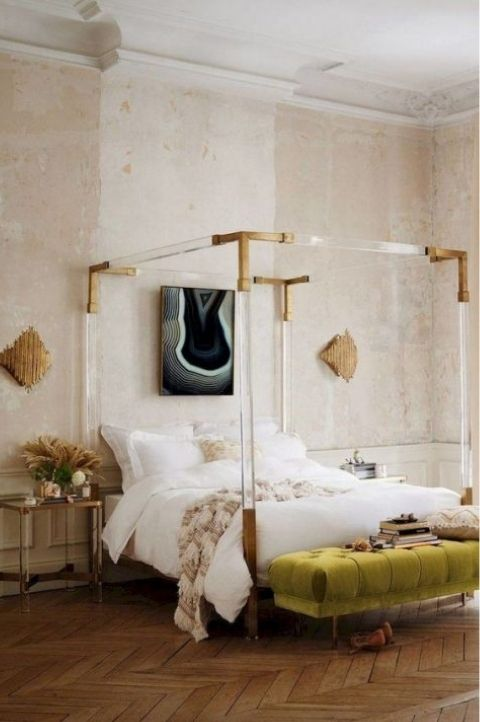 rough walls paired with a gold gilded bed frame