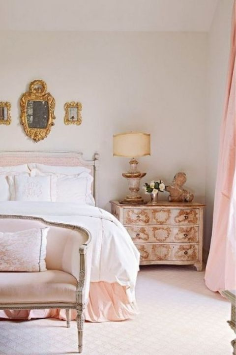 pretty parisian bedroom with pink walls and furnishings