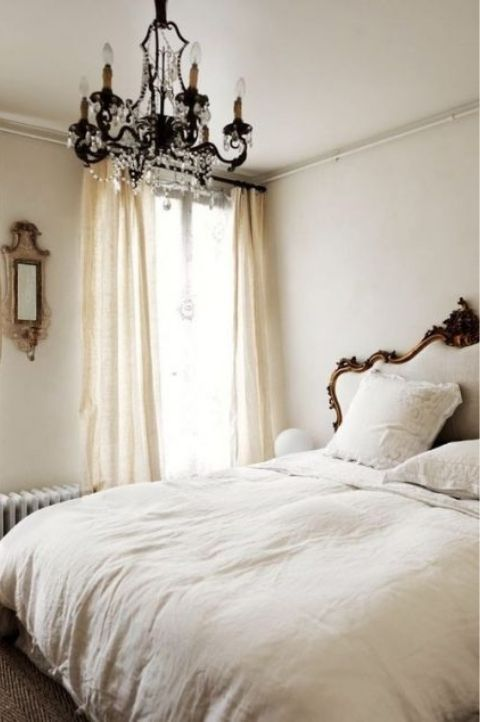 elegant and cozy parisian bedroom with draping chandelier