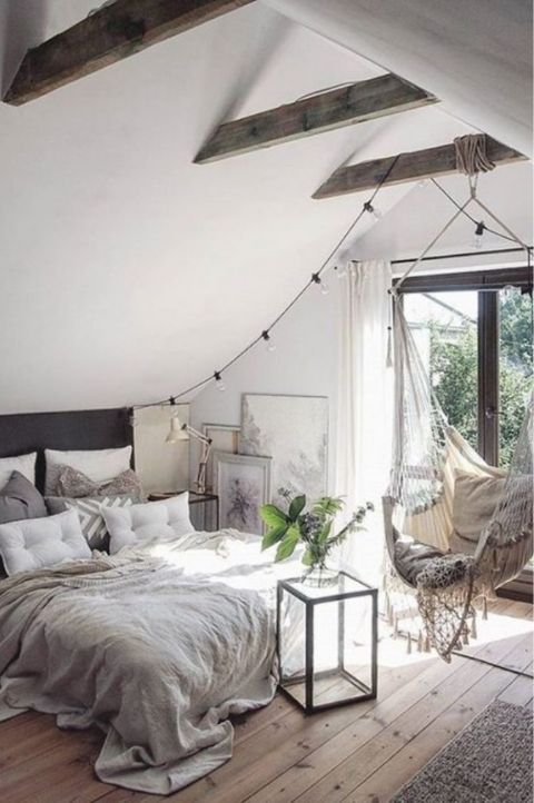 Lovely Scandinavian bedroom with hanging canopy on exposed beam