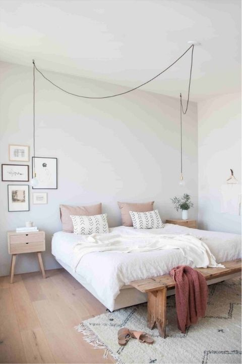 Scandinavian bedroom with a floating bed