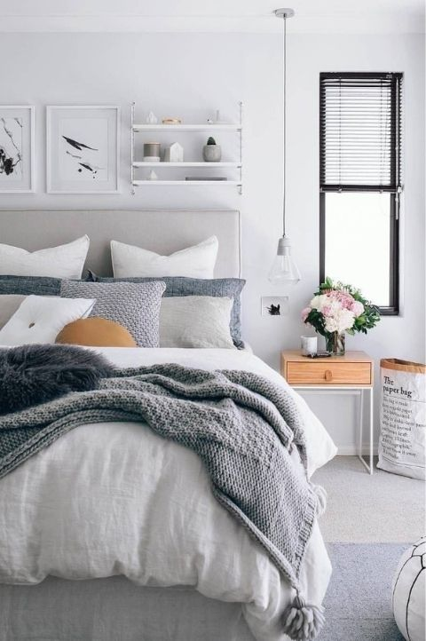 Scandinavian bedroom with faint orange dashes of color