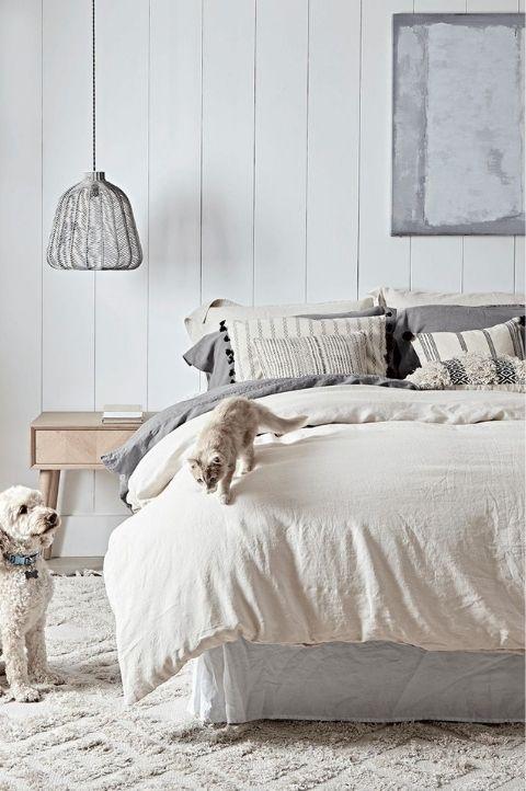 Scandinavian bedroom with textured linens and fabrics