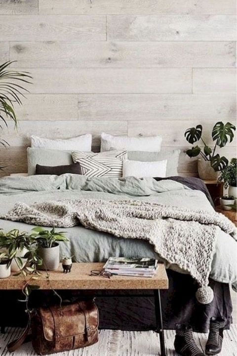 stunning hygge room with bright wood panelling and cozy throws