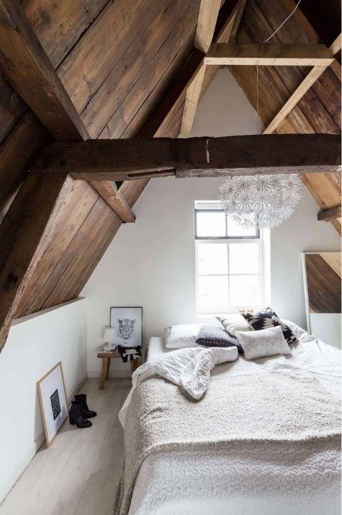 rustic wood cabin Scandinavian bedroom with few accessories