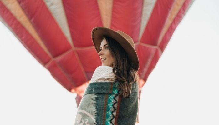 a woman enjoying a hot air balloon ride as part of her bucket list