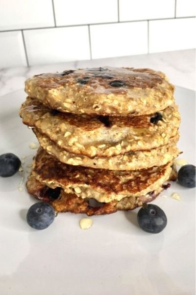 a stack of plain flourless, thick blueberry pancakes